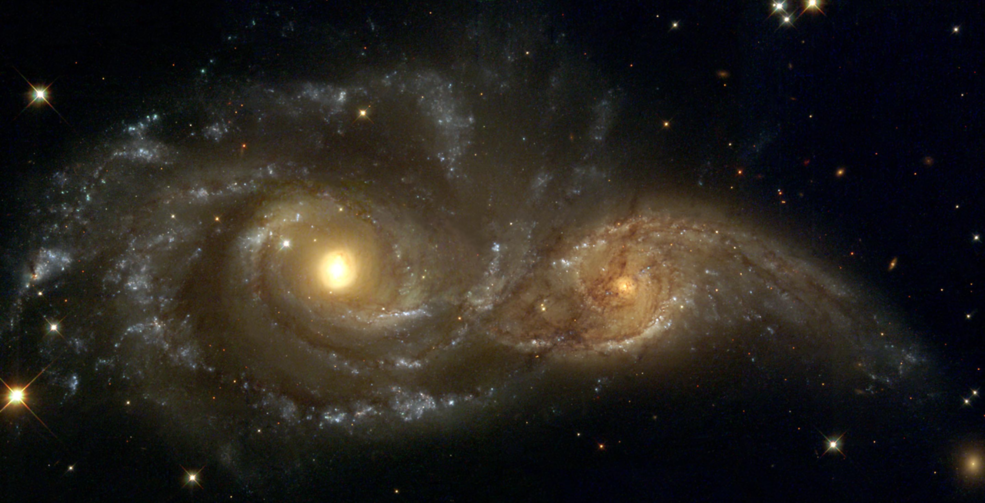 hubble_interacting_spiral_galaxies_ngc_2207_and_ic_2163_2004